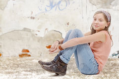 Young preteen sitting on the floor Royalty Free Stock Photography