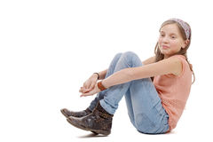 Young preteen sitting on the floor on white Royalty Free Stock Photography