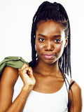Young pretty african-american girl posing cheerful emotional on white background isolated, lifestyle people concept Royalty Free Stock Photography