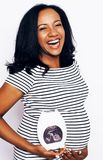 Young pretty african american woman pregnant happy smiling, posi Royalty Free Stock Photo