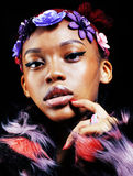 Young pretty african american woman in spotted fur coat and flow Royalty Free Stock Image