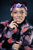 Young pretty african american woman in spotted fur Stock Image