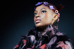 Young pretty african american woman in spotted fur Royalty Free Stock Photos