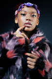 Young pretty african american woman in spotted fur Stock Photos
