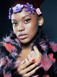 Young pretty african american woman in spotted fur Royalty Free Stock Images