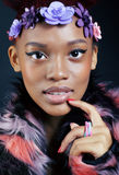 Young pretty african american woman in spotted fur Stock Images