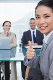 Young pretty applicant showing thumb up after obtaining the job Royalty Free Stock Image