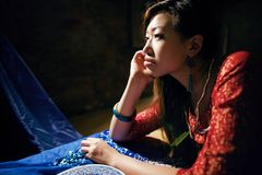 Young pretty asian girl in bright colored interior Royalty Free Stock Photo