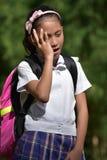 Tired Catholic Asian Female Student Wearing School Uniform With Books