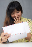 Young pretty Asian girl look surprised doc Royalty Free Stock Image