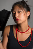 Young pretty Asian girl with red beads Stock Photos