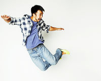 Young pretty asian man jumping cheerful against white background Stock Photo