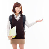 Young pretty Asian student indicate side space Royalty Free Stock Image