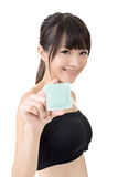 Young pretty asian woman with a condom Royalty Free Stock Photo
