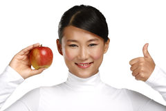 Free Young Pretty Asian Woman Eating An Apple Royalty Free Stock Image - 35976936