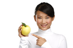 Young pretty asian woman eating an apple Stock Photography