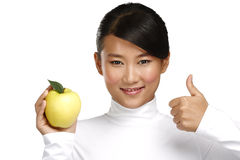 Young pretty asian woman eating an apple Royalty Free Stock Photo