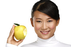 Young pretty asian woman eating an apple Royalty Free Stock Photos