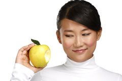 Young pretty asian woman eating an apple Stock Photo