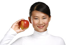 Young pretty asian woman eating an apple Royalty Free Stock Image
