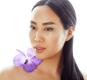 Young pretty asian woman with flower orchid close Stock Photos