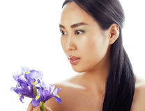 Young pretty asian woman with flower orchid close Royalty Free Stock Images
