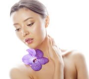 Young pretty asian woman with flower orchid close Royalty Free Stock Photo