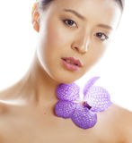 Young pretty asian woman with flower orchid close Stock Photo