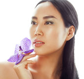 Young pretty asian woman with flower orchid close up isolated spa Stock Photos