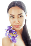 Young pretty asian woman with flower orchid close up isolated spa Stock Images