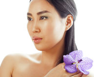 Young pretty asian woman with flower orchid close up isolated spa Stock Photography