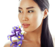 Young pretty asian woman with flower orchid close up isolated spa Stock Image