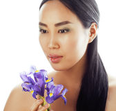 Young pretty asian woman with flower orchid close up isolated spa Royalty Free Stock Photography