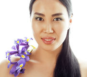 Young pretty asian woman with flower orchid close up isolated spa Royalty Free Stock Photo