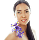 Young pretty asian woman with flower orchid close up isolated spa Royalty Free Stock Image