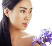 Young pretty asian woman with flower orchid close up isolated spa Royalty Free Stock Photos