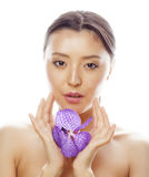 Young pretty asian woman with flower orchid close Royalty Free Stock Photography