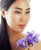 Young pretty asian woman with flower orchid close up  spa Royalty Free Stock Images