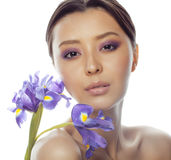 Young pretty asian woman with flower purple orchid close up isolated on white background spa, healthcare concept Royalty Free Stock Photos
