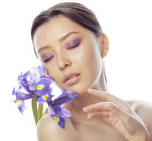 Young pretty asian woman with flower purple orchid close up isolated on white background spa, healthcare concept Stock Photos