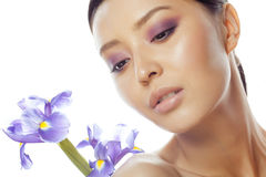 Young pretty asian woman with flower purple orchid close up  on white background spa, healthcare concept Stock Photo
