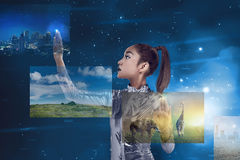 Young pretty asian woman inside digital world. Virtual reality concept Stock Photo