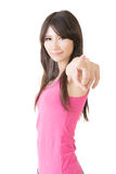 Young pretty asian woman pointing forward Royalty Free Stock Photography