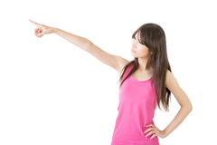 Young pretty asian woman pointing to the left Stock Photo