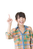 Young pretty asian woman pointing up Stock Image