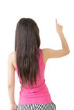 Young pretty asian woman pointing up Royalty Free Stock Photography