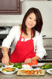 Young Pretty Asian Woman Preparing in Kitchen Royalty Free Stock Photo