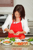 Young Pretty Asian Woman Preparing in Kitchen Royalty Free Stock Images