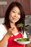 Young Pretty Asian Woman Preparing in Kitchen Royalty Free Stock Image