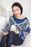 Young pretty Asian woman with smart phone. Royalty Free Stock Images